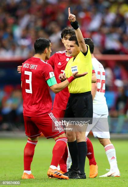 Ehsan Haji Safi of Iran argues with Referee Andres Cunha during the 2018 FIFA World Cup Russia group B match between Iran and Spain at Kazan Arena on...