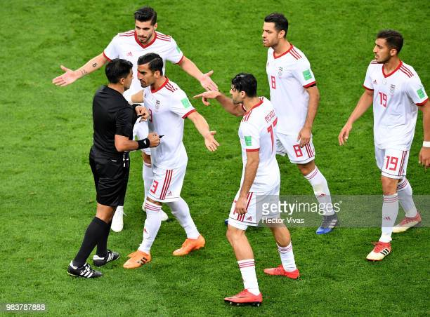 Ehsan Haji Safi of Iran argues with Referee Enrique Caceres during the 2018 FIFA World Cup Russia group B match between Iran and Portugal at Mordovia...