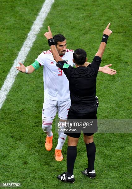 Ehsan Haji Safi of Iran argues with the referee Enrique Caceres after he awards Portugal with a penalty during the 2018 FIFA World Cup Russia group B...
