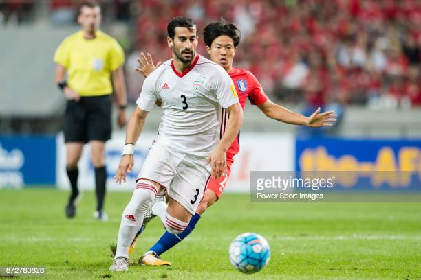 Ehsan Haji Safi of Iran fights for the ball with Kwon Changhoon of Korea Republic during their 2018 FIFA World Cup Russia Final Qualification Round...
