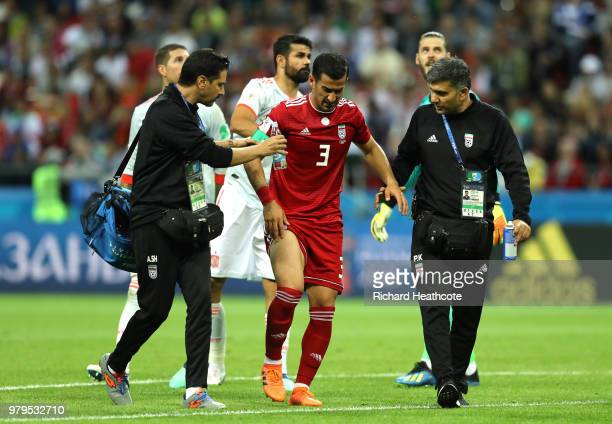 Ehsan Haji Safi of Iran leaves the pitch injured during the 2018 FIFA World Cup Russia group B match between Iran and Spain at Kazan Arena on June 20...