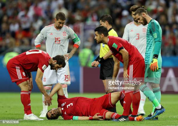 Ehsan Haji Safi of Iran lies on the pitch injured during the 2018 FIFA World Cup Russia group B match between Iran and Spain at Kazan Arena on June...