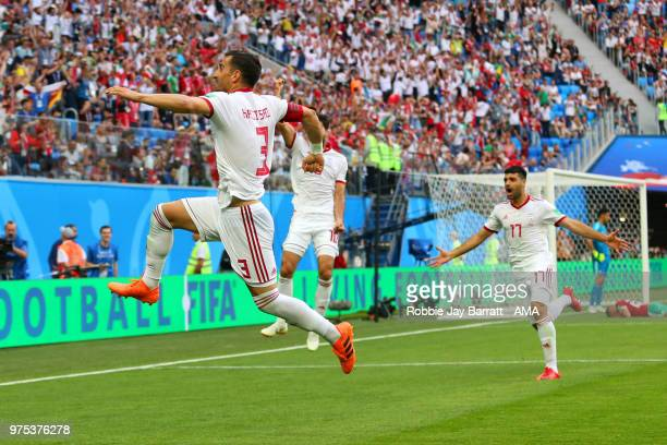 Ehsan Jaji Safi of IR Iran and his teammates celebrate after Aziz Bouhaddouz of Morocco scored an own goal to make it 01 during the 2018 FIFA World...