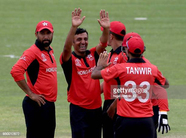 Ehsan Khan of Hong Kong celebrates with teamates after taking the wicket of Grame Cremer of Zimbabwe during the ICC Cricket World Cup Qualifier...