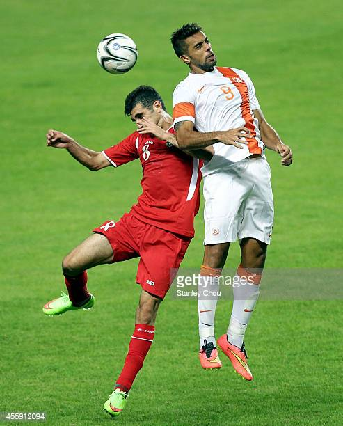 Ehsan Manel Farhan Haddad of Jordan battles with Robin Singh of India during the Football Mens Group G match between India and Jordan during day...
