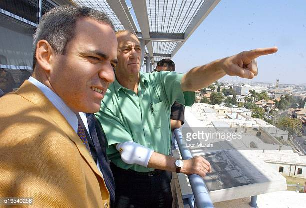 Ehud Olmert mayor of Jerusalem point his hand towards the Dome of the rock next to Former world chess champion Garry Kasparov in Jerusalem on...