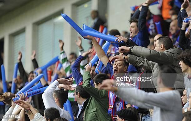 Eibar football team's fans celebrate a goal during the match Eibar vs Lugo at the Ipurua stadium in Eibar on May 31, 2014. AFP PHOTO/ RAFA RIVAS