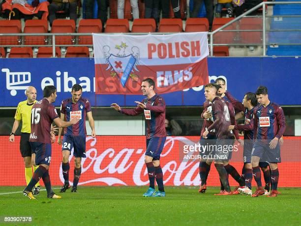Eibar players celebrate their second goal during the Spanish league football match SD Eibar vs Valencia CF at the Ipurua stadium in Eibar on December...
