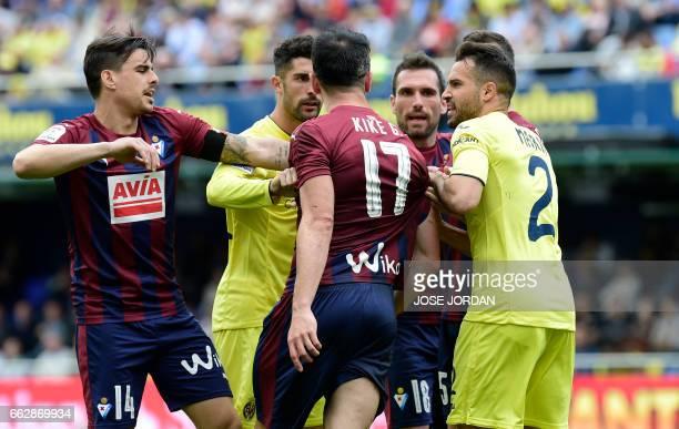 TOPSHOT Eibar players clash with Villarreal players during the Spanish league football match Villarreal CF vs SD Eibar at Estadio de la Ceramica in...