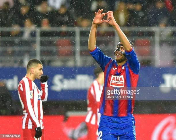 Eibar's Argentinian defender Esteban Burgos celebrates his goal during the Spanish league football match between SD Eibar and Club Atletico de Madrid...