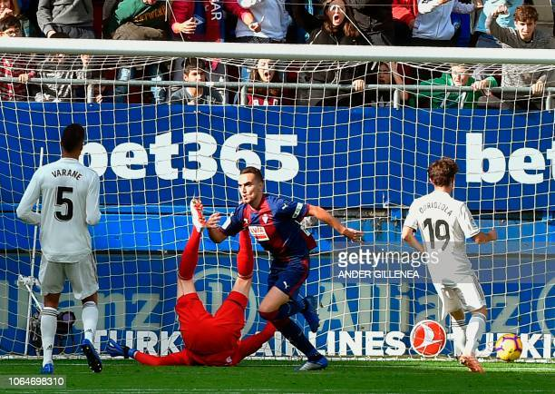 Eibar's Argentinian midfielder Gonzalo Escalante celebrates after scoring during the Spanish league football match between SD Eibar and Real Madrid...