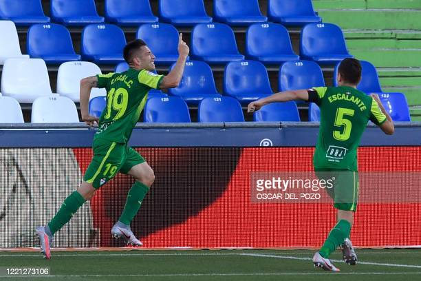Eibar's Brazilian forward Charles celebrates after scoring during the Spanish League football match between Getafe and Eibar at the Alfonso Perez...