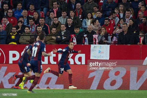 Eibar's Chilean midfielder Fabian Orellana celebrates after scoring during the Spanish league football match Sevilla FC against SD Eibar at the Ramon...