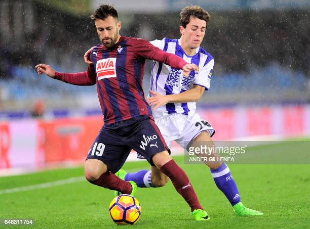 CORRECTION Eibar's defender Antonio Luna vies with Real Sociedad's defender Alvaro Odriozola during the Spanish league football match Real Sociedad...