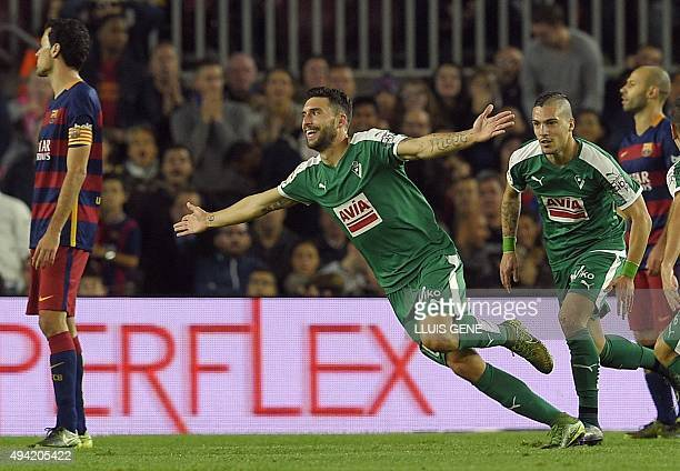 Eibar's forward Borja Gonzalez celebrates after scoring a goal during the Spanish league football match FC Barcelona vs SD Eibar at the Camp Nou...