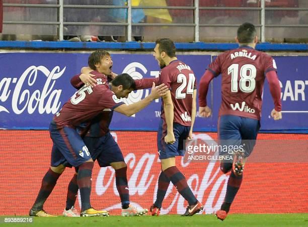 Eibar's Japanese midfielder Takashi Inui celebrates a goal with teammates during the Spanish league football match SD Eibar vs Valencia CF at the...