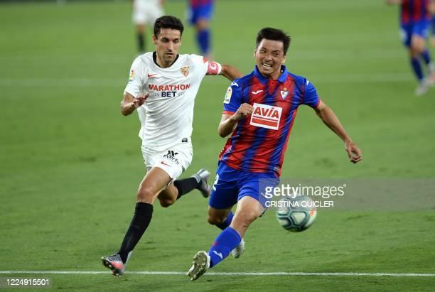 Eibar's Japanese midfielder Takashi Inui vies with Sevilla's Spanish midfielder Jesus Navas during the Spanish League football match between Sevilla...
