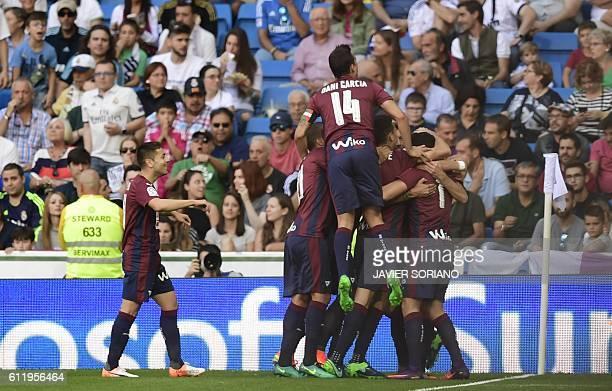 Eibar's midfielder Eibar players celebrate after scoring a goal during the Spanish league football match Real Madrid CF vs SD Eibar at the Santiago...