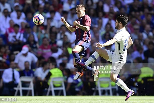 Eibar's midfielder Eibar's midfielder Fran Rico vies with Real Madrid's midfielder Isco during the Spanish league football match Real Madrid CF vs SD...