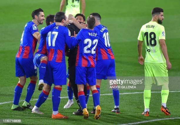 Eibar's players celebrate after Eibar's Serbian goalkeeper Marko Dmitrovic scored during the Spanish league football match SD Eibar against Club...