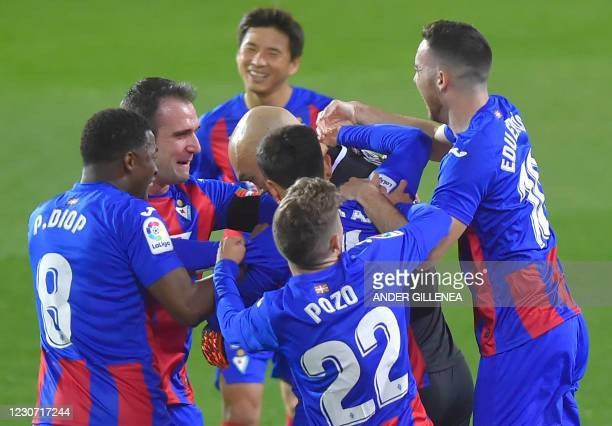 Eibar's players celebrate after Eibar's Serbian goalkeeper Marko Dmitrovic scored during the Spanish league football match SD Eibar against Club...