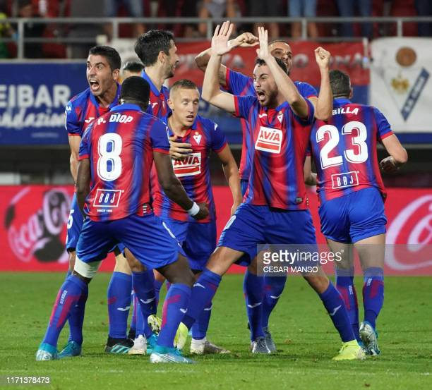 Eibar's players celebrate after winning the Spanish league football match between SD Eibar and Sevilla FC at the Ipurua stadium in Eibar on September...