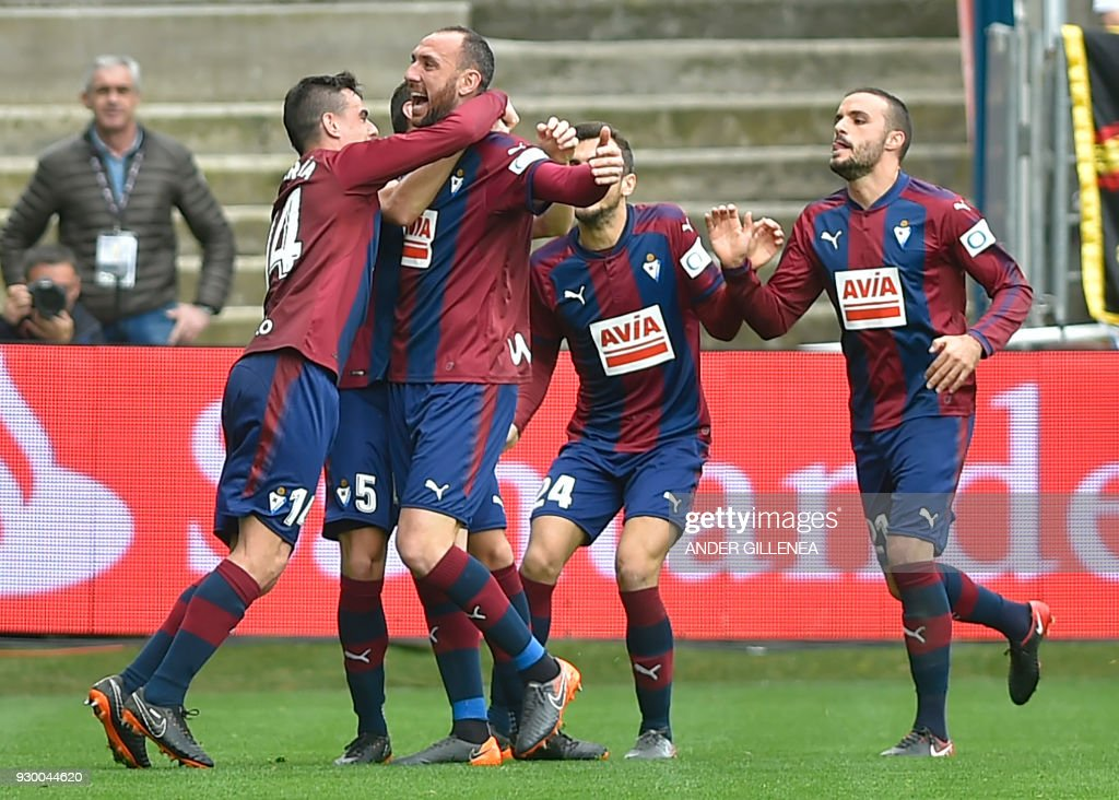Eibar's Spanish defender Ivan Ramis (2ndL) celebrates with teammates after scoring a goal during the Spanish league football match between Eibar and Real Madrid at the Ipurua stadium in Eibar on March 10, 2018. /
