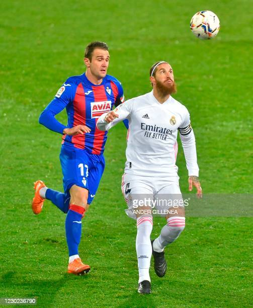 Eibar's Spanish forward Kike Garcia challenges Real Madrid's Spanish defender Sergio Ramos during the Spanish league football match between SD Eibar...