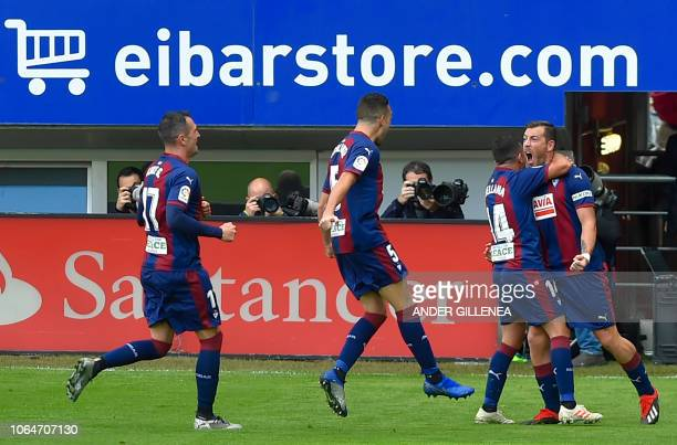 Eibar's Spanish forward Sergi Enrich celebrates with teammates after scoring during the Spanish league football match between SD Eibar and Real...