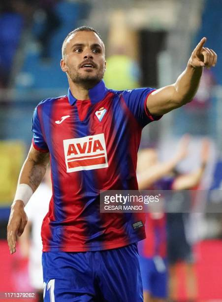 Eibar's Spanish midfielder Pedro Leon celebrates after scoring a goal during the Spanish league football match between SD Eibar and Sevilla FC at the...
