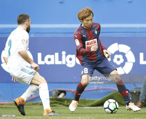 Eibar's Takashi Inui controls the ball while being marked by Real Madrid's Daniel Carvajal Ramos during the second half of a La Liga match in Eibar...