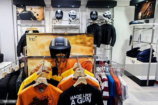 Eicher Motors Ltd. Royal Enfield-branded merchandise are displayed for sale at the company's Royal Enfield flagship dealership in Gurgaon, India, on...