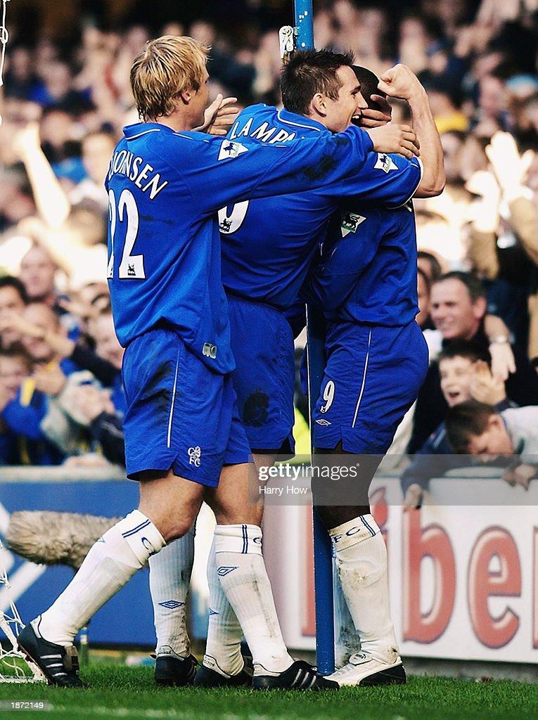 Eidur Gudjohnsen and Frank Lampard of Chelsea congratulate goalscorer Jimmy Floyd Hasslebaink after he scored the first goal : News Photo