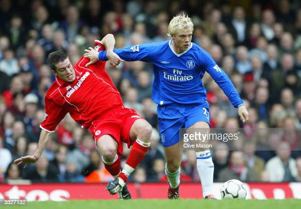 Eidur Gudjohnsen of Chelsea battles for the ball with Frank Queudrue of Middlesbrough during the FA Barclaycard Premiership match between Chelsea and...