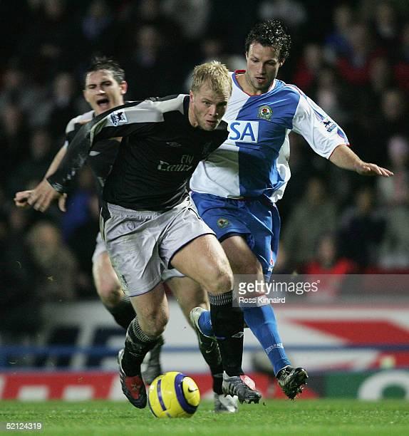 Eidur Gudjohnsen of Chelsea beats Lucas Neill of Blackburn during the Barclays Premiership match between Blackburn Rovers and Chelsea at Ewood Park...