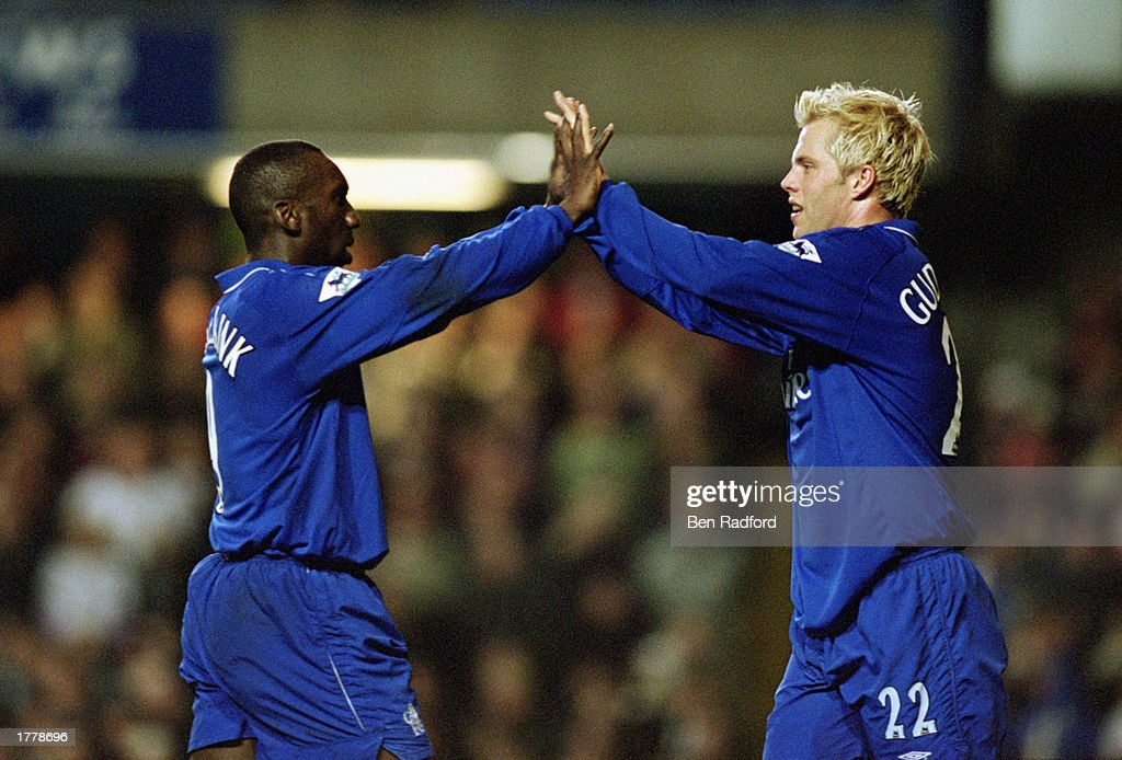 Eidur Gudjohnsen of Chelsea celebrates his goal with team-mate Jimmy Floyd Hasselbaink during the FA Barclaycard Premiership match between Chelsea and Fulham held on March 6, 2002 at Stamford Bridge, in London. Chelsea won the match 3-2.