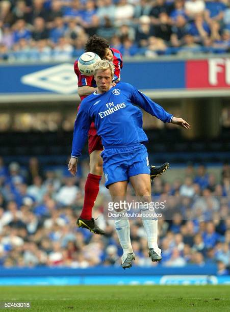 Eidur Gudjohnsen of Chelsea heads the ball away from Gonzalo Sorondo of Crystal Palace during the Barclays Premiership match between Chelsea and...