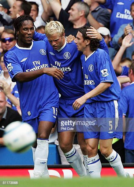 Eidur Gudjohnsen of Chelsea is congratulated by Alexei Smertin and Didier Drogba after he scored their first goal during the Barclays Premiership...