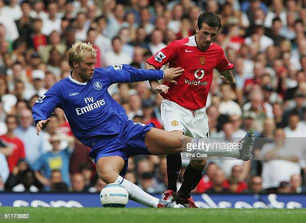 Eidur Gudjohnsen of Chelsea slides in to tackle Liam Miller of Manchester United during the Barclays Premiership match between Chelsea and Manchester...