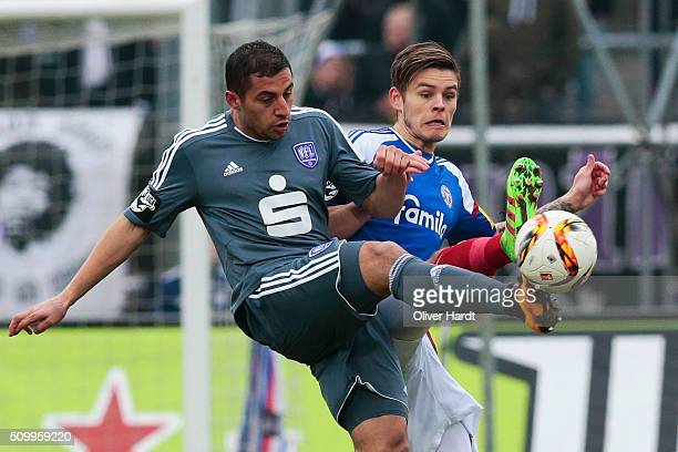 Eidur Sigurbjoernsson of Kiel and Hall Savran of Osnabrueck compete for the ball during the 3 liga match between Holstein Kiel and VfL Osnabrueck at...