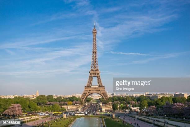eiffel tower against clouds and sky, paris, france - image photos et images de collection