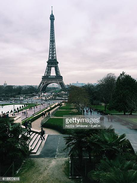 eiffel tower against cloudy sky - simeone stock pictures, royalty-free photos & images