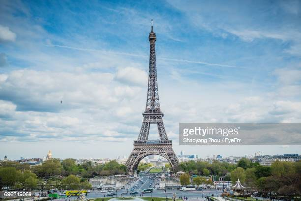 Eiffel Tower Against Cloudy Sky