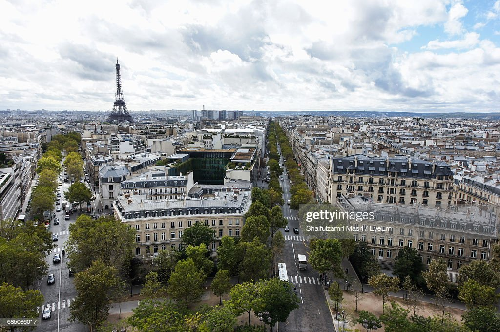 Eiffel Tower Amidst Buildings In City : Stock Photo