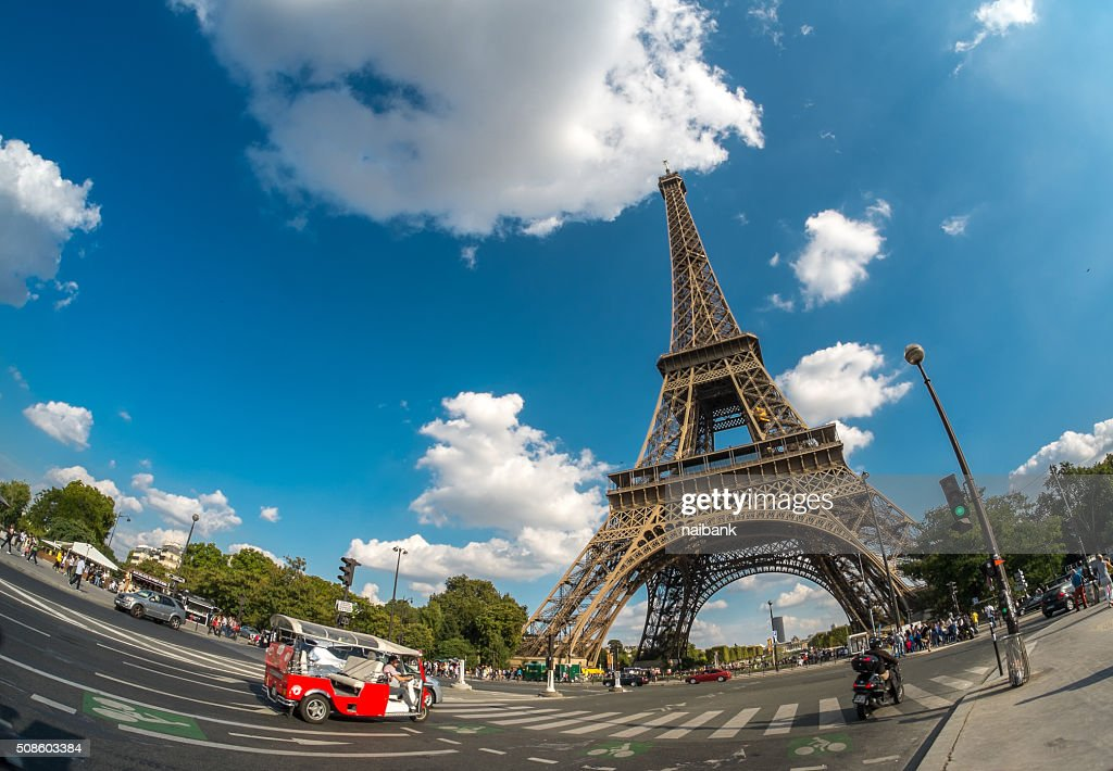 Eiffel tower and a red mini-van : Stock Photo