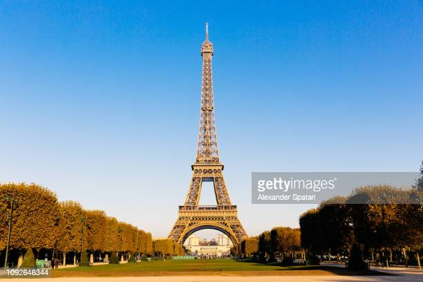 Eiffel Tower and Champ de Mars on a sunny day with clear blue sky, Paris, France