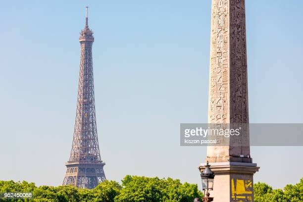 Eiffel tower and obelisk of luxor during day in Paris , France