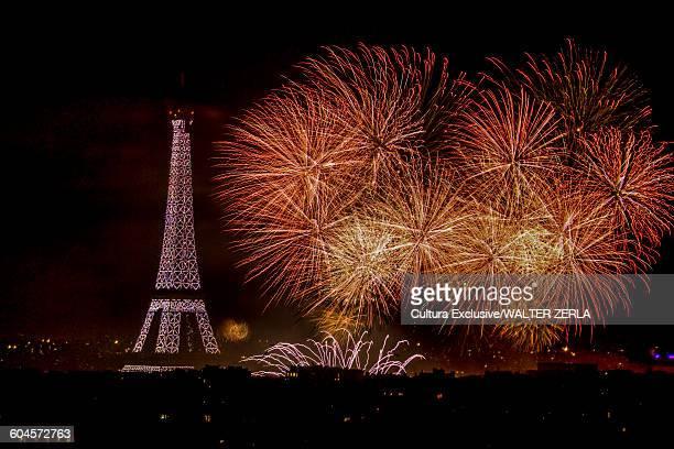 Eiffel Tower and orange fireworks at night, Paris, France