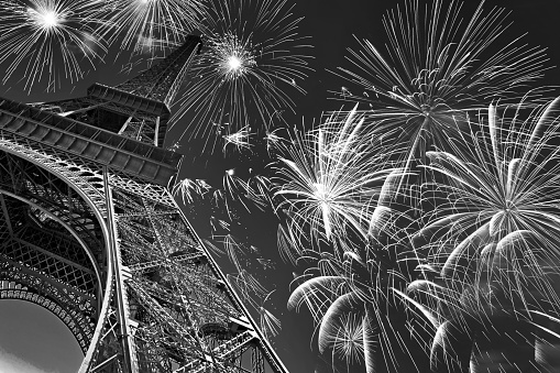 Eiffel tower at night with fireworks, french celebration and party, black and white image, Paris France 689970506