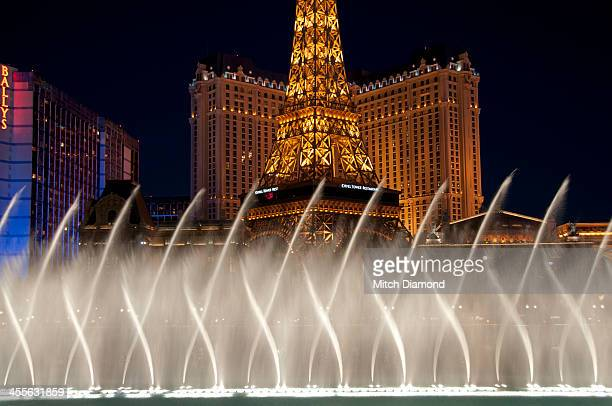 Eiffel Tower at night with fountains